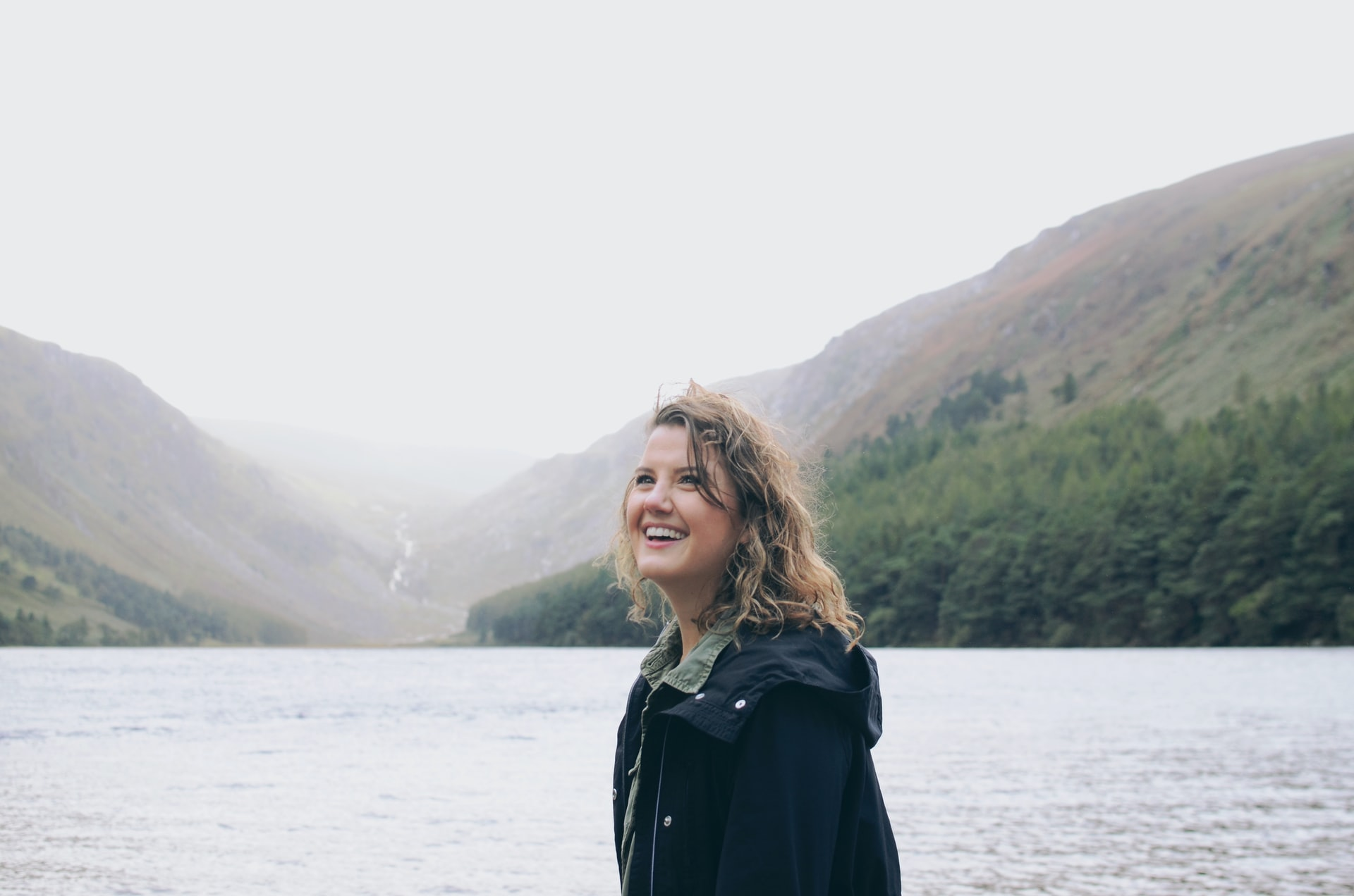 Woman smiling at Glendalough lakes