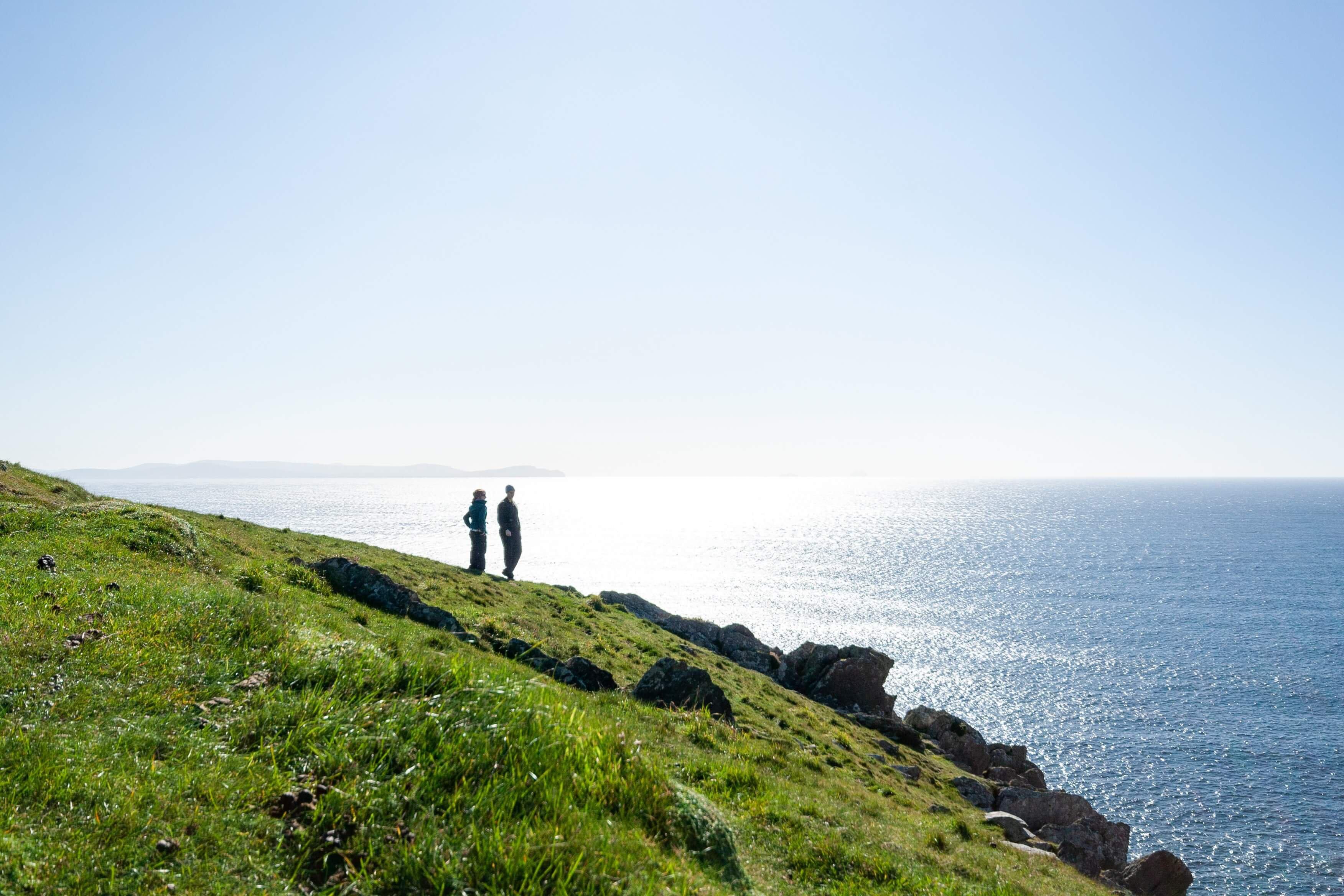 Couple walking on Kerry Coast
